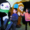 Olympic mascots Miga, left, and Quatchi, met Philip Zhang, 7, his sister Nancy, 9, and many other children at the Healthier You Expo Sunday at the Civic Centre. Sumi at the third mascot was also meeting kids. Citizen photo by David Mah
