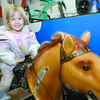 Tanna Savident, 4, rides 'Champion' at Northern Hardware Saturday afternoon, her mom rode the same horse 30 years ago.  Citizen photo by Brent Braaten