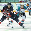 Cougar Dallas Jackson keeps the puck on his stick being chased by Kelowna Rockets Mitchell Callahan during the second period at CN Centre.  Citizen photo by Brent Braaten