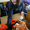 Megan Mcclymot sorts through a box of stuffes animals during the14th annual REAPS Recycle Toy Drive Saturday at the REAPS demo garden on Gorse Street. The toys collected will be give to local childrens organizations. They hoped to collect 300 boxes of toys to distributed.  Citizen photo by Brent Braaten