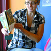 Erin Pfliger reads 'Where the Beasts Are' during childrens story time at Books and Company Saturday morning.  Citizen photo by Brent Braaten