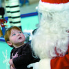Taylor Johnson 10 months trys to get a better look at Santa during her visit with him at Pine Centre Mall Saturday afternoon. Santa will be at the mall every day from 12:30 to 2:00 pm and again from 3:30 -4:30 with extra hours on Saturday and evenings Thursday and Fridays.  Citizen photo by Brent Braaten
