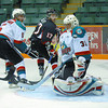 Kelowna Rockets goalie Adam Brown makes a save while Cougar Robbie Ciolfi looks for a rebound being checked by Rocket Mitchell Chapman  during the first period at CN Centre in Prince George.  Citizen photo by Brent Braaten