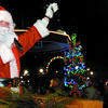 Santa waves to the large crowd at the annual Civic Centre light up ceremony Wednesday night.  Citizen photo by Brent Braaten