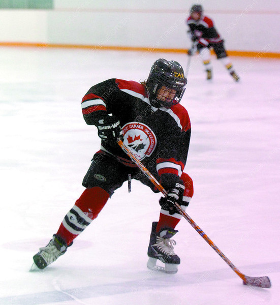 Dylan Ellison, 12, makes a tight turn during drills at the Elkcentre, in the Heather Park Middle School Hockey Skills Academy. 29 students participate 3 days a week. Citizen photo by David Mah