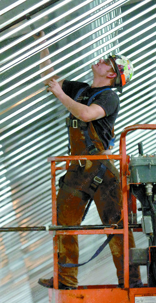 Jordan Matte, with West Central Fire Protection, installs sprinkler pipes in the roof of the new Duchess Park secondary school.  Citizen photo by David Mah
