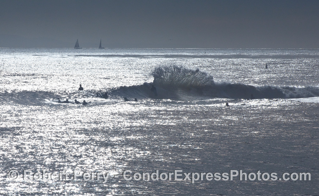 A winter afternoon and the surfers enjoy the waves at the Sandspit, Santa Barbara Harbor.