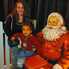 The Santa statue was popular for photos as seen here with Dante Meyer, 2, and his aunt Gerri Graham. Citizen photo by David Mah