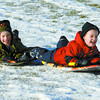 Liam Fortier, 5, and Perry Fortier, 5, enjoy sliding at the fields near College Heights Secondary Monday morning.  Citizen photo by Brent Braaten