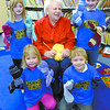 Jean Warburton, 85, centre has students from Vanway Elementary school, Kendra Nicholson ,6, back left, Tavin Fefchak, 7, back right, Grace Colquhou, 6, front left, and Kodi Finlayson, 6,  show off the mitts she knitted for students at the school. This is the second year she has done this. Warburton has been knitting all her life, she won her first award for her work at age 4.  Citizen photo by Brent Braaten