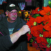 Annette and Ray Maze, looked closely at the poinsetta baskets at the Festival of the Trees. Citizen photo by David Mah