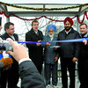 Mayor Dan Rogers and members from the Guru Nanak Sikh Temple gather at the official opening of a new bus shelter on davis road Wednesday morning. The city has recently upgraded 9 tranit shelters and 15 concrete pads to ensure the transit system is more user friendly and accessable.  Citizen photo by Brent Braaten