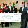 Shriners make a $10,000 donation to Spirit of the North Healthcare foundation to purchase equipment in the endoscopy clinic. From left to right John Rowe, Neil Weller, Carol Beebe, Prsident of the spirit of the North Healthcare Foundation, Lenard Timmins, David Fleck and Mel Snatinski. citizen photo by Brent Braaten