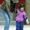 Tahlia McKenzie, 3, and her mom, Tracy, had a great time in the fresh snow as they skated at the Civic Centre Plaza Thursday night. Citizen photo by David Mah