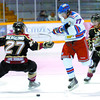 Prince George Spruce King Brooks Robinson, launches himself through Westside Warriors Izaak Berglund, and Trevor Bailey, in the first period at the Prince George Coliseum. Westside led 3 - 0, after the first period Thursday night. Citizen photo by David Mah