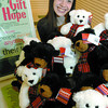 Elise Brown and some teddy bears at the Gift of Hope.  Citizen photo by Brent Braaten