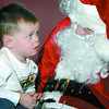 blake Arthur,2, has a chat with Santa during the 7th Annual Child Care Association Christmas breakfast. About 125 children attended the event held at the Salvation Army on Ospika. All the daycares participating in the breakfast also brought donations of childrens items and food to the.   Citizen photo by Brent Braaten