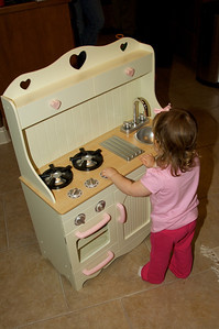 Granny & Pawpaw brought her a kitchen!