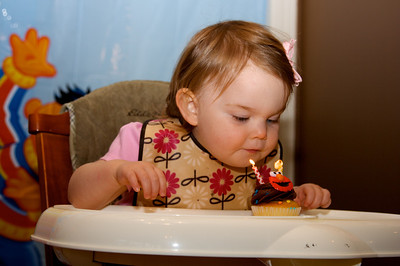 Trying so hard to blow out her candles