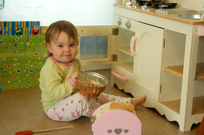 Playing with her new kitchen after the party was over
