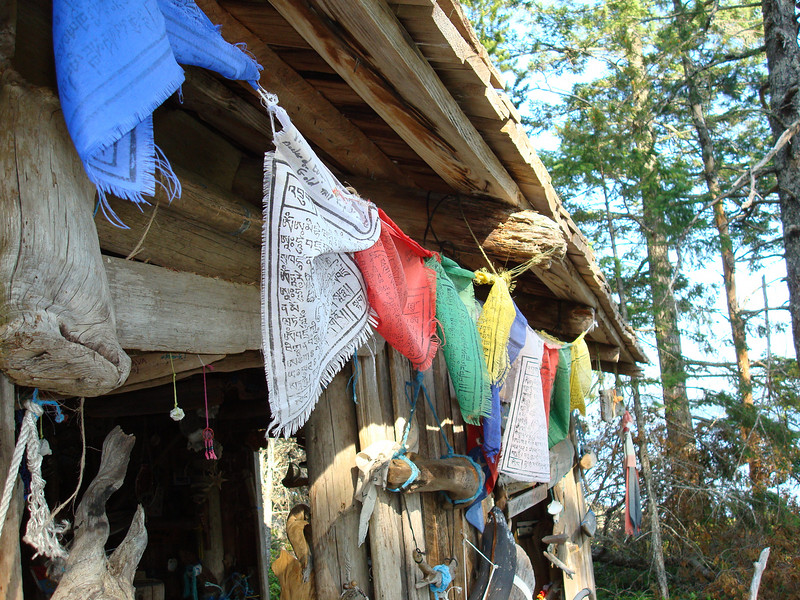 prayer flags outside the boat cabin