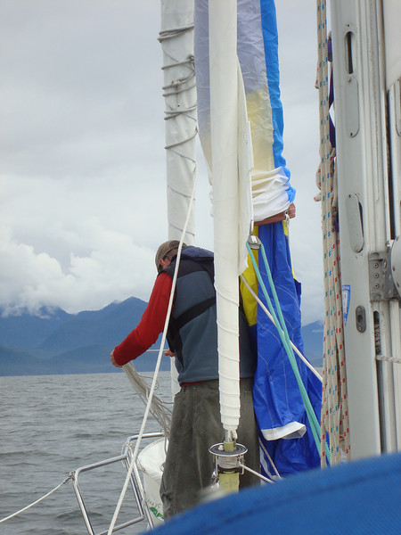 Jason untangling the spaghetti pile of lines on our asymmetrical spinnaker