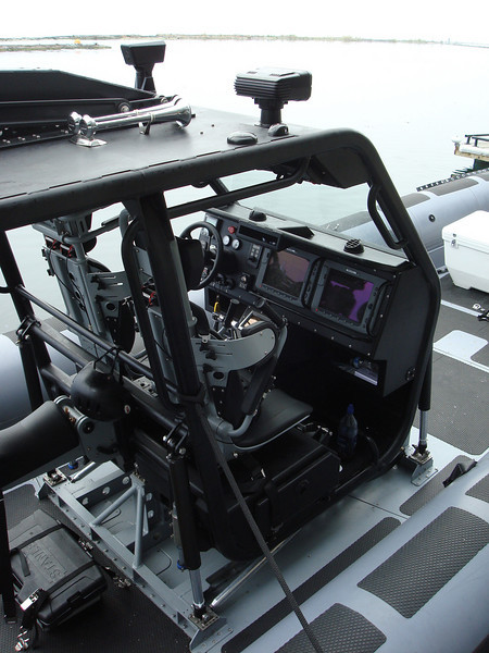 the cockpit of this boat was suspended from hydraulics, the pilots wore helmets
