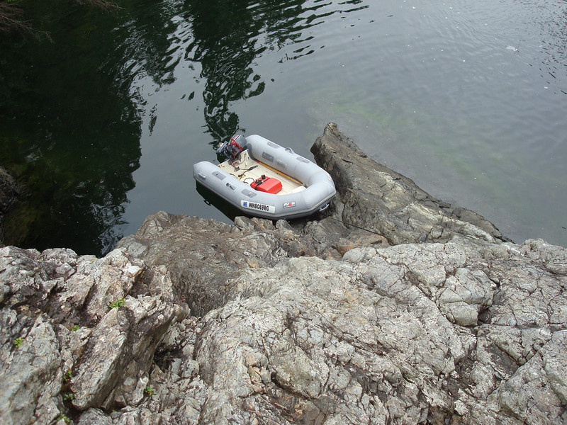 our dinghy tied up at the entrance of Lucky Falls