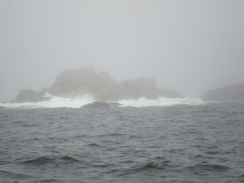 uncomfortably close to breaking surf in the fog