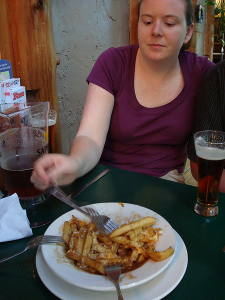 digging into a nice greasy plate of Canadian happiness - poutine!
