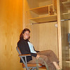 Christy sitting at a locker