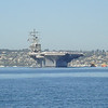 an aircraft carrier coming into San Diego bay