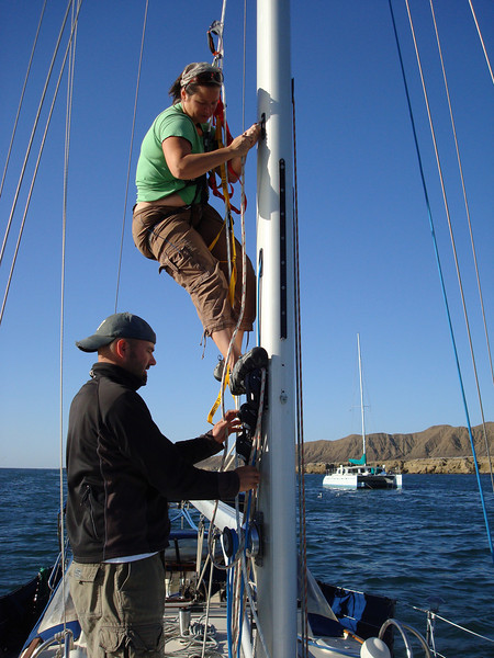 Christy attempting to fix the halyard in Turtle Bay