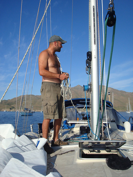 Jason fishing the end of the new spinnaker halyard