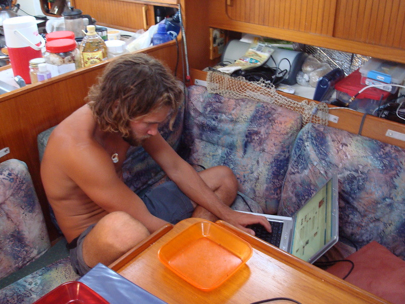 Colin busily updating Facebook whilst at anchor in Los Frailes