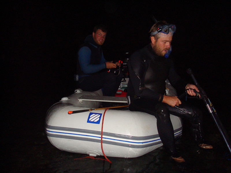 Kevin from s/v Pahto and Elias from s/v Stepping Stone doing some spearfishing at night