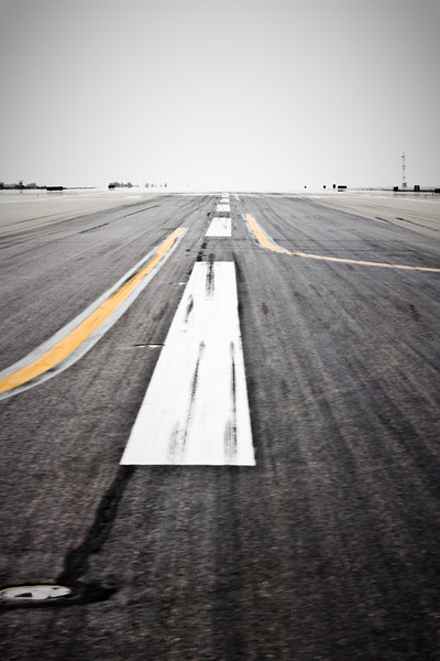 Forest fire haze obscures the skies as heat waves shimmer over the runway pavement.