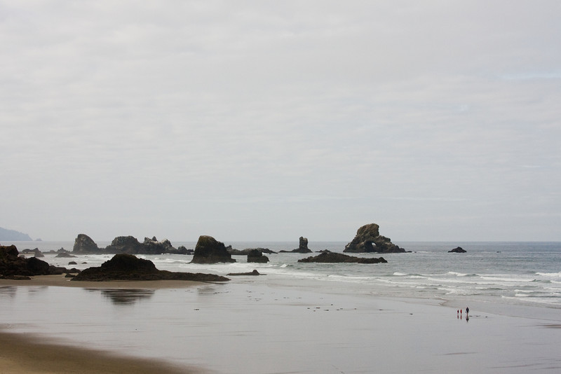 Oregon's Indian Cove endures the waves under a cloudy sky.