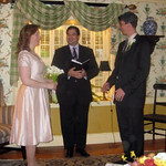Amy and Kirby take the vows of marriage while Craig officiates (photo courtesy of Eva)
