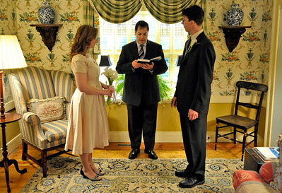 Amy and Kirby take the vows of marriage while Craig officiates