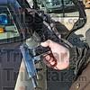 Weapon: Sheriff's deputy Greg Ewing holds a confiscated semi-automatic handgun taken in an early morning multi-agency raid in southwestern Vigo Co.