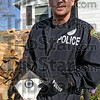 Bird's-eye view: Vigo Co. Drug Task Force officer Denzil Lewis holds a birdhouse containing a video security camera taken from a residence raided by police Thursday morning.