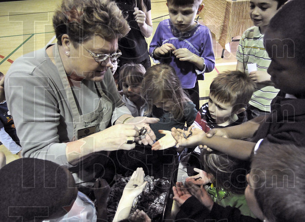 Worm lady: Sister Terri Boland shows a group of Meadows School kids some worms during their Green Day activities Thursday morning.