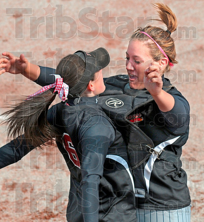 Intro-bump-tion: Terre Haute South's on-field leader Tiffany Fendrick (R) bumps Ciara Hall as she's being introduced at the start of the West Vigo game.