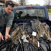 Tribune-Star/Joseph C. Garza<br /> Planting the future: City Forester Bill Kincius loads red oak seedlings into the back of a city truck at Otter Creek Middle School Thursday. The seedlings will be given to students at DeVaney and Fayette Elementary Schools Friday for Arbor Day.