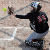 Catcher: Tiffany Fendrick catches an incoming pitch during a recent game. She's the team leader on the field.