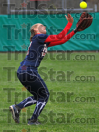 Eye contact: Patriot firstbaseman Hailee Travioli snares a fly ball.