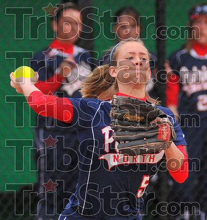 In time: Patriot thirdbaseman Danielle Ketner throws to first after fielding a ground ball.