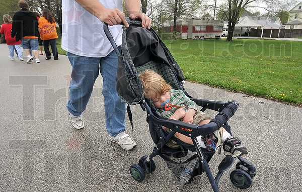 Tribune-Star/Joseph C. Garza<br /> Innocent: Dominic Morin sleeps as his dad, Phil Morin, participates in the 2009 Homeward Bound Walk Sunday on the National Heritage Trail. Phil and his wife, Carin, lost their home in March when their apartment building was severely damaged by fire.