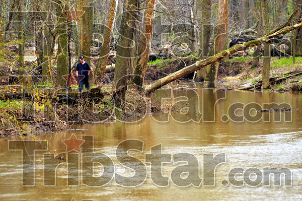 Search effort: One of the many volunteers that turned out searches the muddy waters of Otter Creek just upstream from Hasselburger Road.